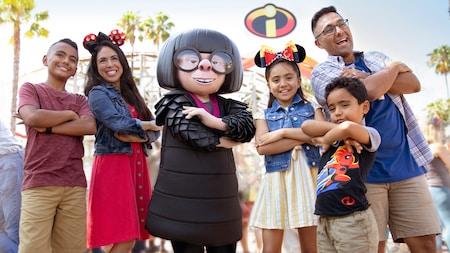 A family poses next to Edna Marie E Mode