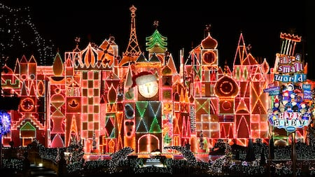 The it's a small world Holiday attraction adorned with festive lighting and seasonal images