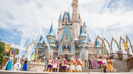 Against the backdrop of Cinderella Castle stands the full cast of Mickey's Friendship Faire, including Mickey Mouse and friends, as well as characters from such Disney classics as Frozen and Tangled