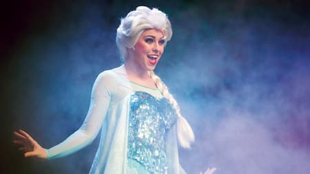 Elsa performs on a foggy stage during For the First Time in Forever: A Frozen Sing-Along Celebration