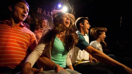 Guests of all ages scream excitedly while experiencing a drop on The Twilight Zone Tower of Terror