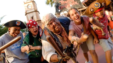 Captain Jack Sparrow's shipmate Mack and 4 budding pirates wielding wood clubs
