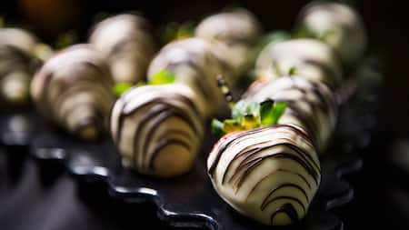 Strawberries covered in white chocolate, available at the Happy HalloWishes Dessert Premium Package