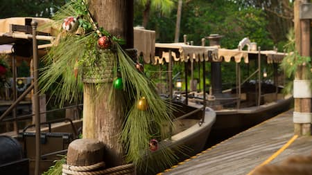 Jungle Cruise decorated with pine needles and Christmas ornaments