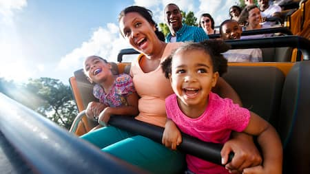 A family smiles on a rollercoaster
