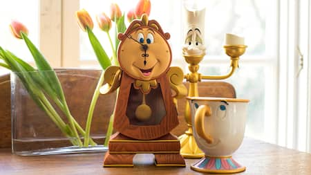 Ceramic household objects in the shapes of Cogsworth, Lumière and Chip from 'Beauty and the Beast'