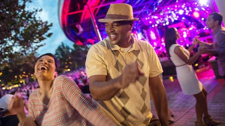 A couple rockin' out on the outdoor dance floor at Epcot