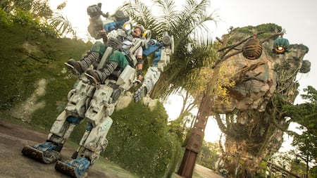 A pilot maneuvers a ten foot high Pandora Utility Suit within Pandora The World of Avatar