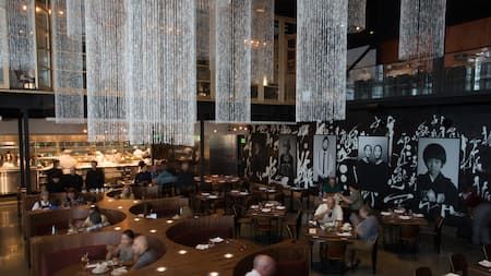 Vast modern interior of Morimoto Asia, with 2-story chandeliers, private rooms and an open kitchen
