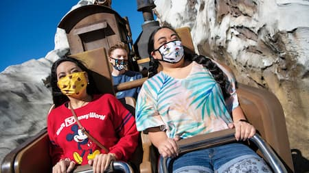 3 Guests wearing face masks while riding Expedition Everest Legend of the Forbidden Mountain