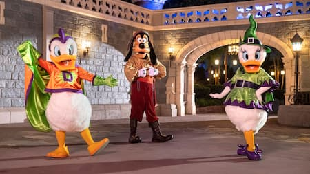 Donald Duck, Goofy and Daisy Duck are ready to party as they strike a pose, dressed in their Halloween best