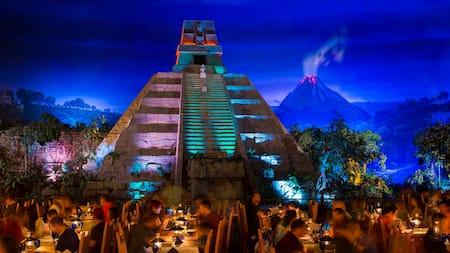 The dining room at San Angel Inn Restaurante, featuring a replica Mayan pyramid set against a night sky