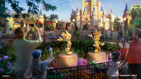 An artist depiction of park guests standing near golden sculptures of Mickey Mouse and Minnie Mouse near Cinderella Castle at Magic Kingdom park.