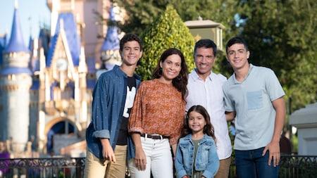 A family posing for a Disney photographer