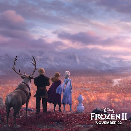 Anna, Elsa, Olaf, Kristoff and Sven standing on a cliff overlooking a valley, and words that read 'Disney Frozen II November 22'