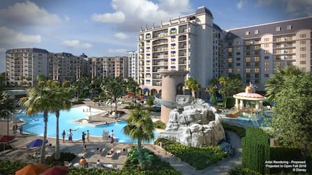 A large pool, tall waterslide and palm covered lounge area at a multi story resort with balconies