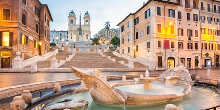 The Fontant della Barcaccia at the base of the Spanish Steps and the Trinita dei Monti church
