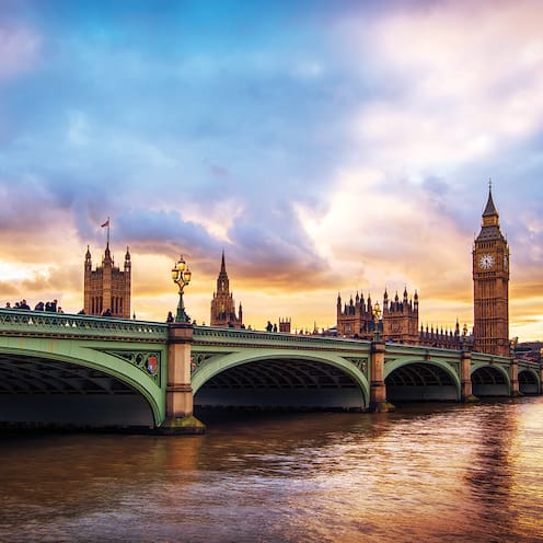 The River Thames flowing under the Westminster Bridge near landmarks
