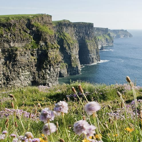 The Cliffs of Moher loom over the sea