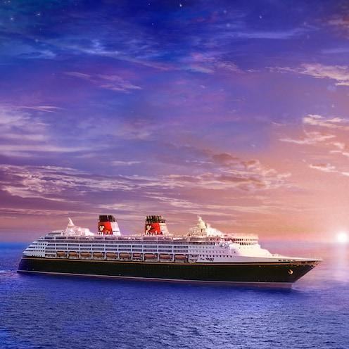 The Disney Magic cruise ship sail across the sea at sunset