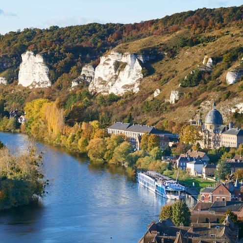 Cliffs dot the hilly landscape of the riverside town of Les Andelys, France