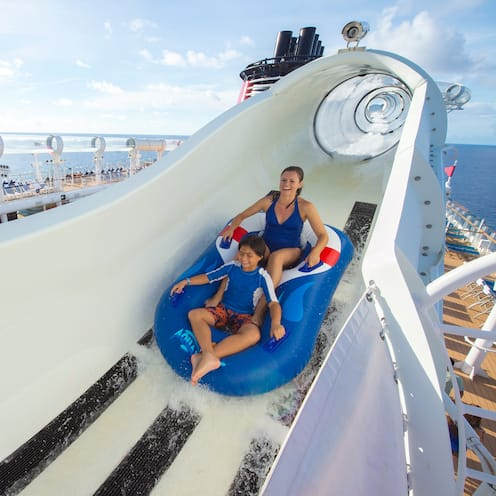Two Guests ride a boat down the AquaDuck water coaster on the Disney Fantasy cruise ship