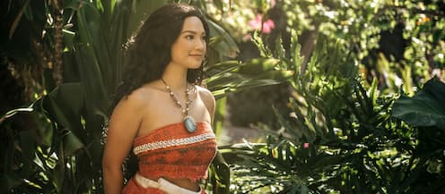 Moana wearing her magical necklace