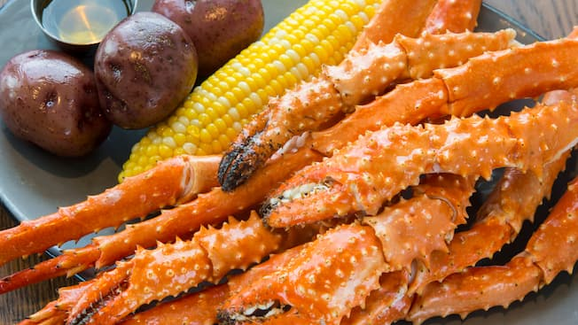 Roast potatoes, corn on the cob, crab legs and an Orlando magazine emblem for the 2018 Dining Awards Readers' Choice for Best Seafood Restaurant