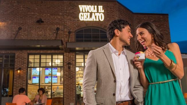A couple eats gelato outside Vivoli Il Gelato