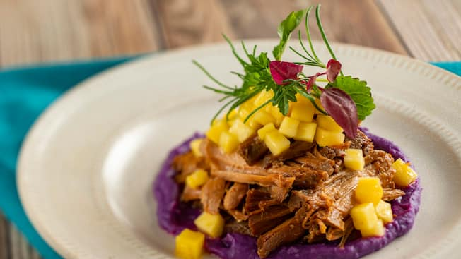 Kahlua pork with pineapple, garnished with herbs