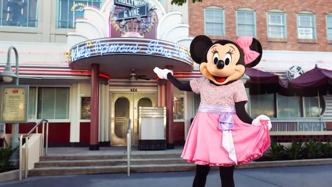 Minnie Mouse strikes a pose in front of Hollywood and Vine wearing party attire