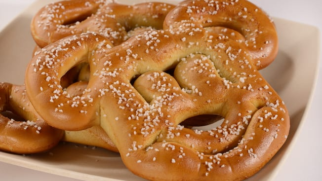 A plate holding soft pretzels in the shape of Mickey Mouse's face