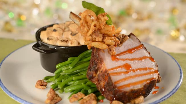 Porkchop served with green beans and sweet potato casserole