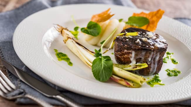 A filet on a plate with vegetables