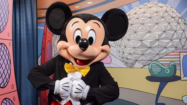 Mickey Mouse in front of an image of Epcot