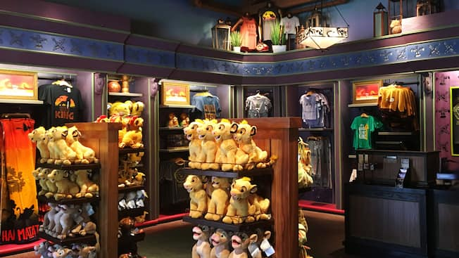 Simba plush toys, tees and other merchandise on display
