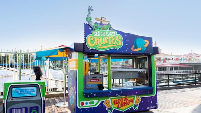 A sign featuring Buzz Lightyear identifies Senor Buzz Churros, an eatery