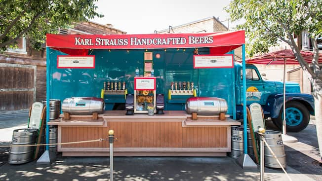 A sign atop a kiosk identifies it as Karl Strauss Handcrafted Beers
