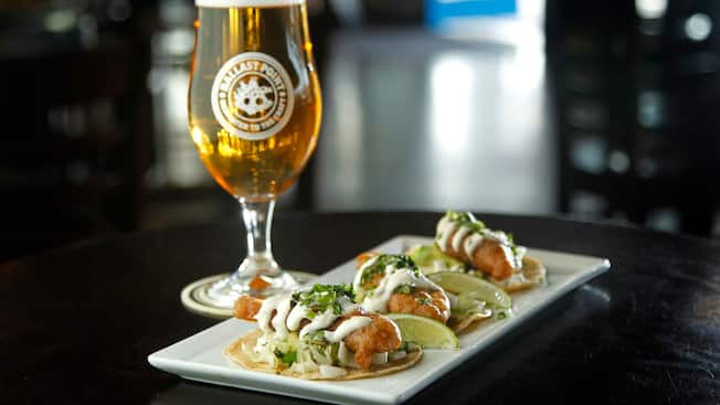 3 softshell fish tacos served with a pint of beer