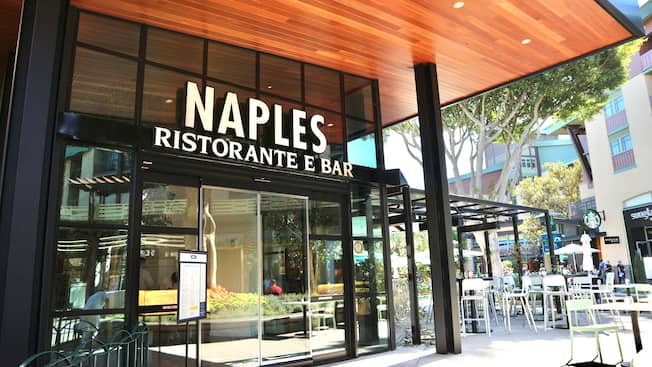 The modern style entrance to Naples Ristorante e Bar with outdoor seating