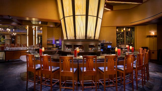 An elegant circular bar with high backed chairs at Napa Rose Lounge.