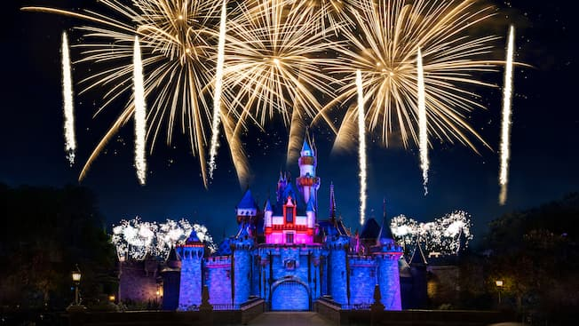 An amazing fireworks spectacular lights up the night over Sleeping Beauty Castle