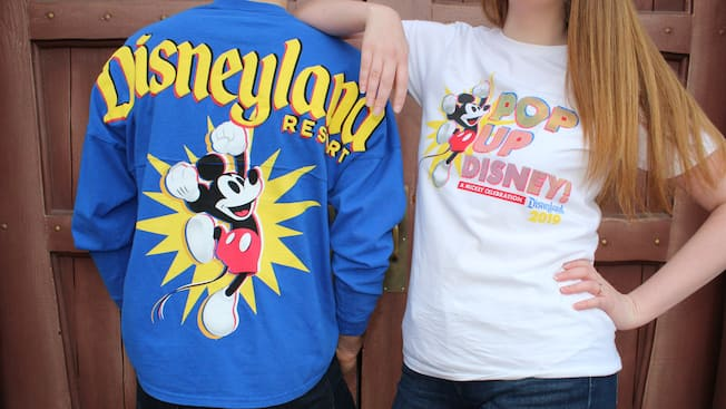 2 young Guests model clothing that features Mickey Mouse
