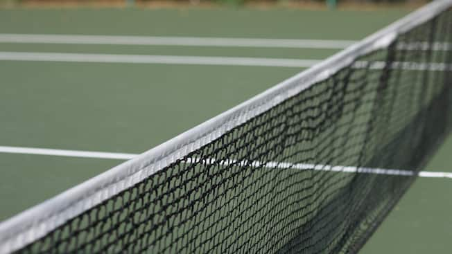 Close-up of a tennis court net