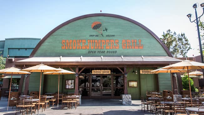 Exterior of Smokejumpers Grill with tables, chairs and umbrellas at Disneys California Adventure Park
