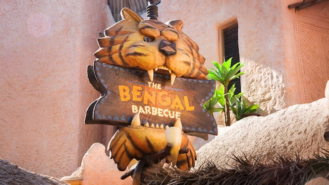 Sign with wood carving of a tiger's head, The Bengal Barbecue restaurant in Disneyland Park