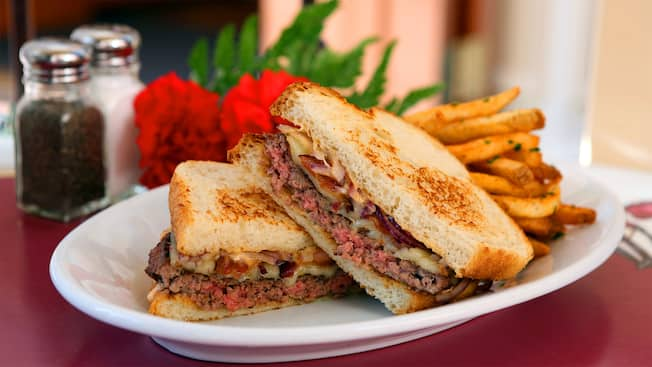 A plated serving of the sourdough bacon cheese melt with French fries from Carnation Cafe