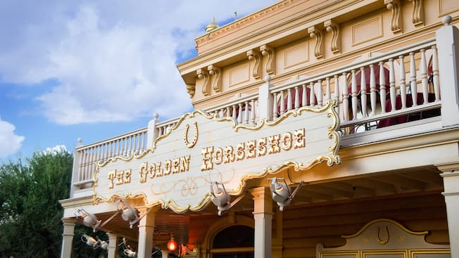 The Golden Horseshoe sign for the theatre and dining location in Frontierland