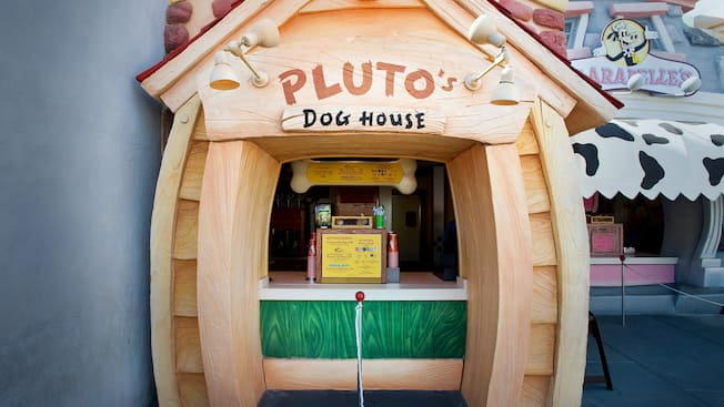 Sign and menu for Pluto's Dog House, a hot dog stand at Disneyland Park