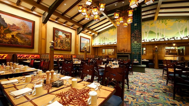 Wide shot of dining tables, framed paintings and Storytellers Café Arts and Crafts decor